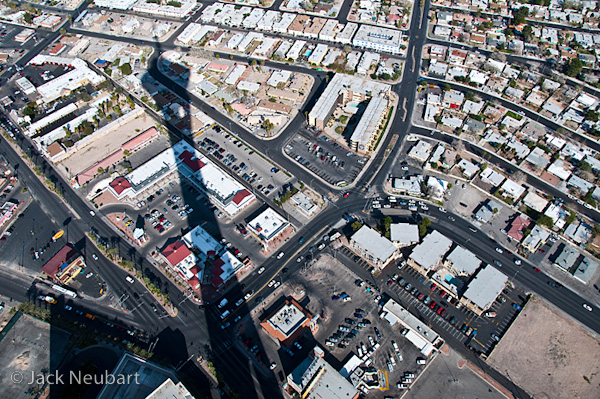 LANDSCAPE. For this street scene with the menacing tower shadow (shot from the Stratosphere tower, Las Vegas), I positioned the lens as squarely as possible against the glass, which was angled downward. Photos Copyright  ©2009 Jack Neubart. All rights reserved.