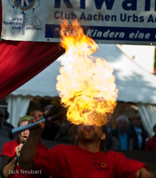 PEOPLE. I came upon this fire-eater at a festival in Aachen, Germany, quite by accident. Grabbing a spot in the crowd, I barely had time to zoom in (112mm/168mm equivalent) and frame the shot before this plume of flame erupted--and you could feel the searing heat from where I was standing.Photo Copyright  ©2009 Jack Neubart. All rights reserved.