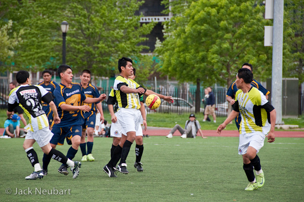 SPORTS. When shooting amateur soccer, I set shutter speed to the fastest possible setting without cranking ISO off the scale, but usually no faster than 1/1000 second to freeze the action. Because there are so many zigs and zags, it's hard to rely on single-shot AF alone, and continuous AF hasn't proved adequate to the task. So after engaging single-shot AF, I manually refocused to target the action.Photo Copyright  ©2009 Jack Neubart. All rights reserved.