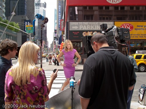 In entertainment news. I was in Times Square (in New York City) when I came upon this scene involving a celebrity reporter preparing to shoot the intro for a daily entertainment TV show. The G10 came in handy. I just pulled it out of a vest pocket, set focal length to the widest position (to encompass the entire scene before me) and shooting mode to Program AE. When I shot tighter, I added flash, but that was inappropriate given the people right in front of me--although they did work nicely as a framing device. ISO 100, 1/160, f/4. Copyright  ©2009 Jack Neubart. All rights reserved.