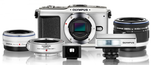 The first Olympus Micro Four Thirds system includes the E-P1 camera, two lenses, adapters for other types of lenses and a compact flash unit.