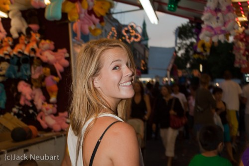 "Candid portrait. I met photographer Abby Ross at an Italian festival in my neighborhood. As she began to walk away, I yelled ""smile,"" at which point she obligingly turned around. I snapped the shot without even looking through the finder, with the flash held a short distance from the camera. You can see this talented photographer's work at www.abbyross.com. Copyright  ©2009 Jack Neubart. All rights reserved."