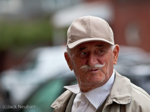 Candid portrait. As this distinguished-looking gentleman passed me on the street, I quickly snapped his picture, then asked him to pose for this shot, captured by available light (ISO 800: f/3.5, 1/400). Copyright  ©2009 Jack Neubart. All rights reserved.