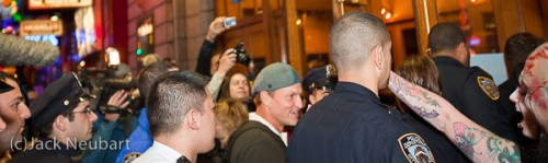 Celebrity sighting. Actor Woody Harrelson entering the movie theater for the premiere of his new flick Zombieland. I know, he's not exactly in focus, but I didn't have time to do more than raise the camera above the heads of the crowd and hope for the best. As it turns out, he's very amiable, to the point of shaking hands with fans. Copyright  ©2009 Jack Neubart. All rights reserved.