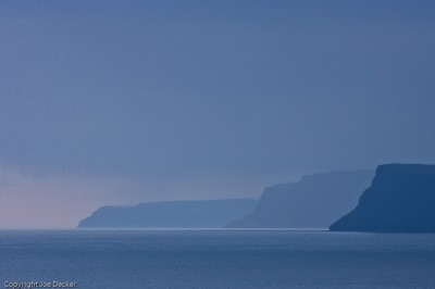 Midnight Dusk, Látrabjarg, Westfjords, Iceland. Effective focal length: 420mm.  The effect of miles of air is part of the flattening in this image.