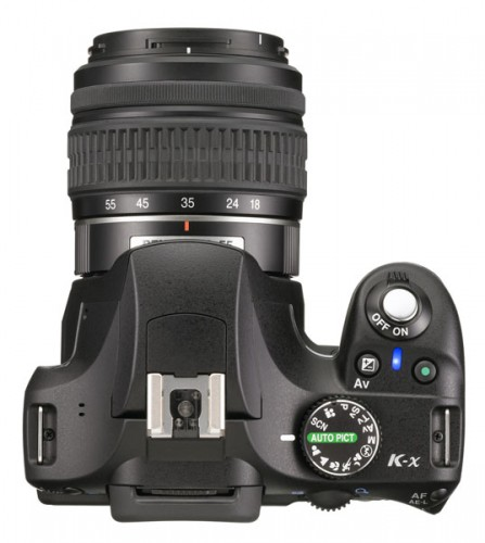 Pentax K-x Black Version--top. The camera features a comfy grip. Photo courtesy of Pentax.